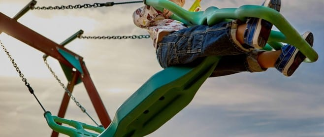 toddler playing on playground 658x278 1