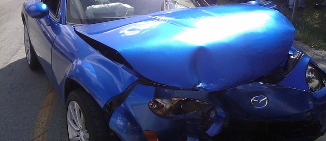 car accident lawyer blue car